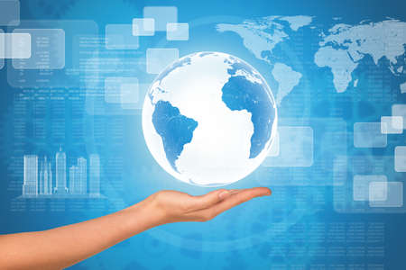 womans: Womans hand with Earth globe on abstract background with world map Stock Photo