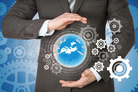 worl: Businessman with planet above his hands on abstract background