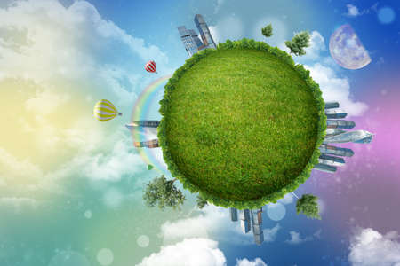 GREEN BUILDINGS: Green globe with city on colorful background with clouds