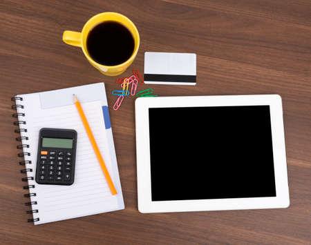 blank tablet: Blank copybook with tablet and calculator on wooden table Stock Photo