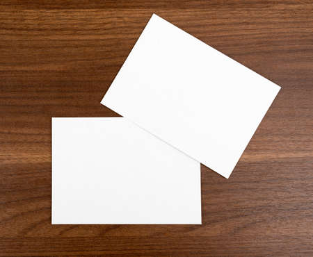 paper sheets: Blank cards on wooden table, top view