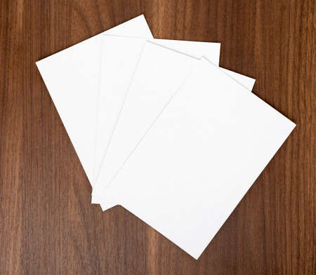 wooden table top view: Blank cards on wooden table, top view