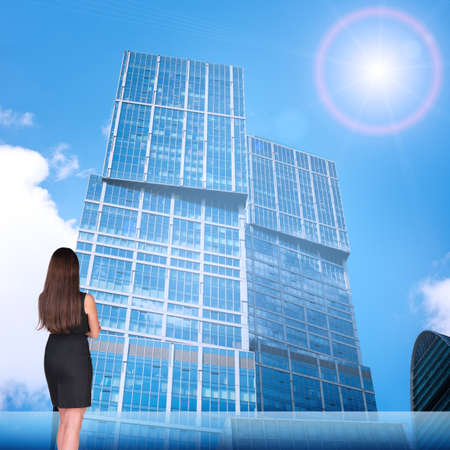 rear view: Businesswoman with on cityscape background, rear view Stock Photo