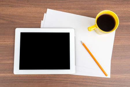 blank tablet: Tablet with blank paper and coffee on wooden table