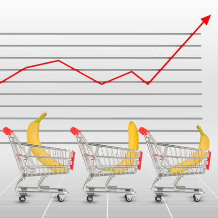 cell growth: Banana in shopping cart on graphical chart background