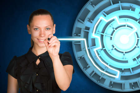 holographic: Woman writing on holographic screen with labyrinth Stock Photo