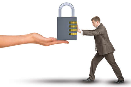 keylock: Hand giving keylock to businessman on isolated white background Stock Photo