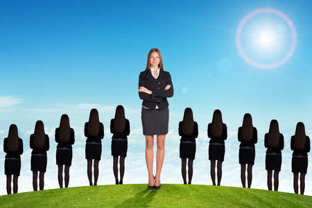 businesslady: Businesslady with crossed arms and looking at camera Stock Photo