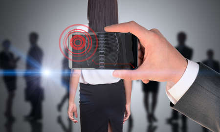 councilor: Businessman holding smartphone with x-ray of woman
