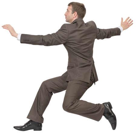 businessman running: Businessman running fast on isolated white background Stock Photo