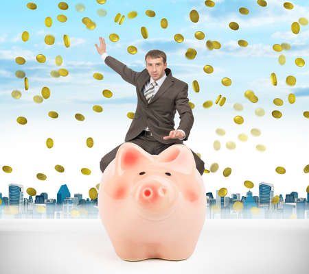 councilor: Businessman sitting on piggy bank on nature background