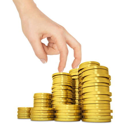 womans: Womans hand with gold coins on isolated white background Stock Photo