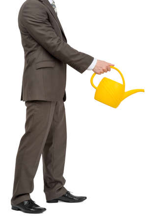 wateringcan: Businessman with watering-can and without head on isolated white background