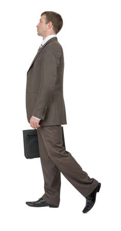 councilor: Businessman walking on isolated white background, side view Stock Photo