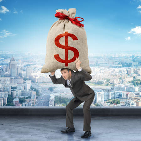 moneybag: Businessman holding big moneybag with dollar sign