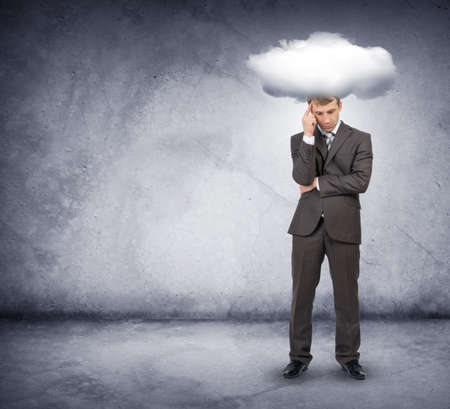 above head: Sad businessman with cloud above head on grey background
