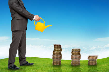 wateringcan: Businessman with watering-can and without head watering coins