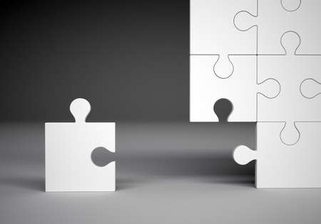 business symbols metaphors: Puzzle pieces on grey background, close up view Stock Photo