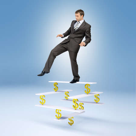 looking down: Businessman standing on balance with dollar sign and looking down