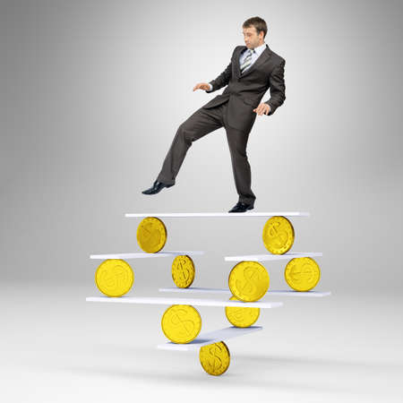 looking down: Businessman standing on balance with gold coins and looking down Stock Photo