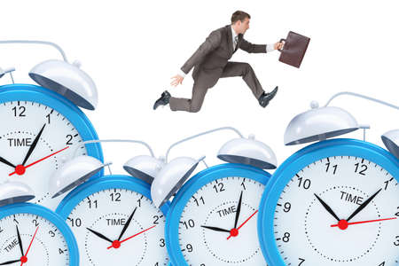 councilor: Businessman running with set of alarm clocks on isolated white background