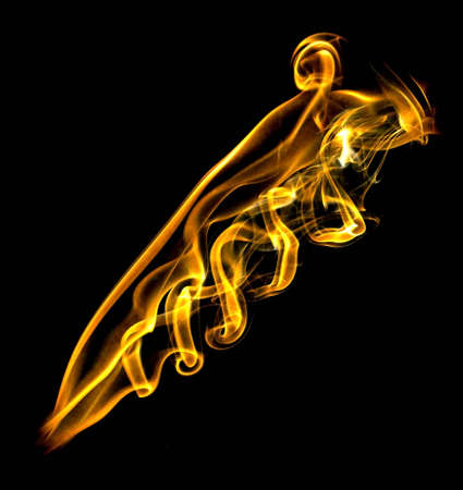 twirls: Gold fire flame with twirls and lightspots Stock Photo