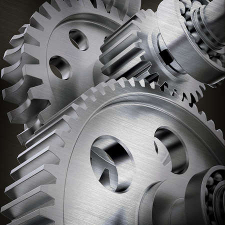 joining together: Metal cog gears joining together, close up view Stock Photo