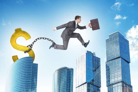 ballast: Image of young businessman with dollar ballast jumping over gap on city background