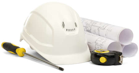 isolated on white: Planning of construction of house. Drawings for building house, helmet and other working tools on white