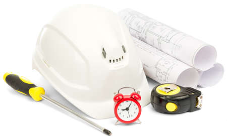 stop time: Alarm clock and helmet, screwdriver on isolated white background