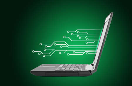 url virtual: Black laptop with lightspot on green background Stock Photo