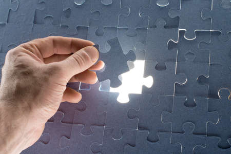 final piece of puzzle: Missing jigsaw puzzle piece for completing the final puzzle piece, closeup