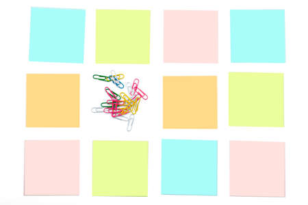 paper clips: Paper clips with colorful stickers on white Stock Photo