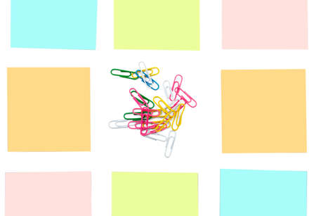 paper clips: Paper clips with colorful stickers on white, closeup
