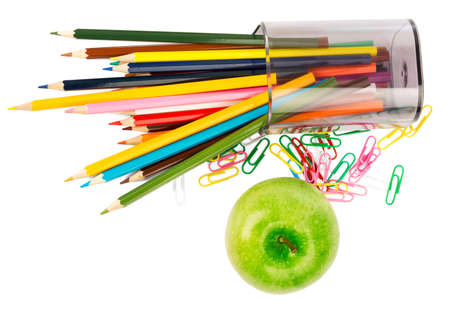 paper clips: Fresh apple with crayons and paper clips on white background Stock Photo