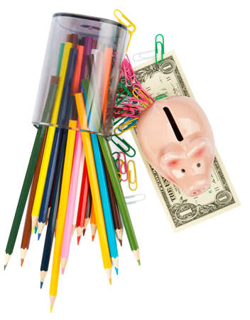 paper clips: Piggy bank with crayons and paper clips on white background Stock Photo