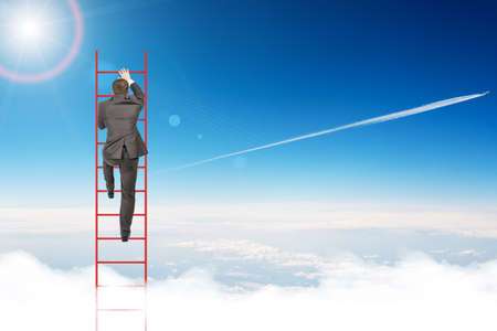 corporate ladder: Businessman climbing ladder on blue sky background, rear view
