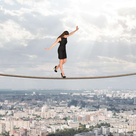 businesslady: Businesslady walking on rope and looking down