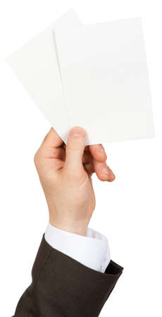 blanks: Businessman holding two small blanks paper on isolated white background Stock Photo