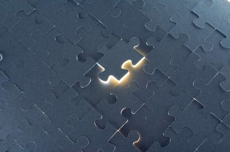 color separation: Grey puzzle background with flying piece, close up view