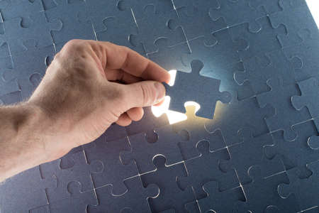 final piece of puzzle: Missing jigsaw puzzle piece for completing the final puzzle piece, white space