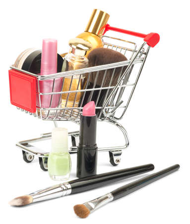 shopping cart: Set of cosmetics tubes in shopping cart with brushes isolated on white background