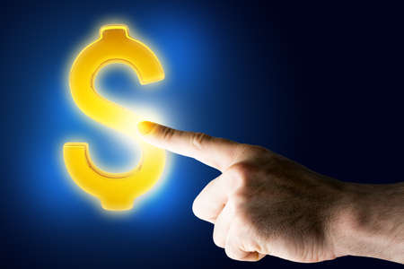 backgound: Hand touching dollar sign on blue backgound Stock Photo