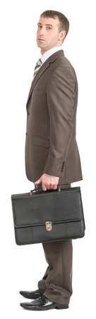 councilor: Businessman standing with suitcase and looking at camera on isolated white background Stock Photo