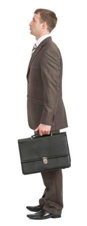 councilor: Businessman standing with suitcase on isolated white background, side view