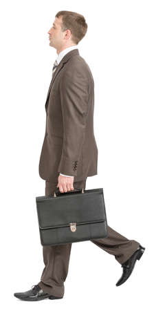 Businessman walking with suitcase on isolated white background, side view Stock Photo