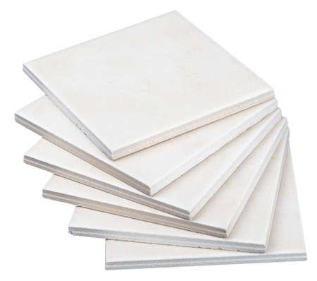 tile background: Pile of white tiles on isolated white background, closeup Stock Photo