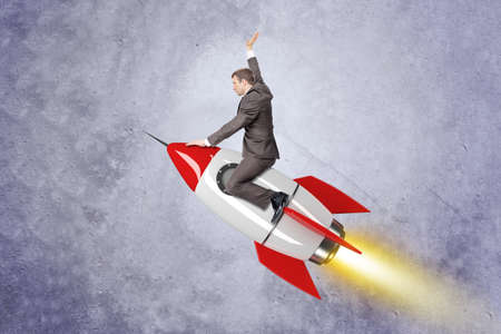councilor: Businessman flying on red rocket on grey wall background