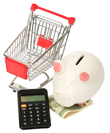 shopping cart isolated: Piggy bank with calculator and shopping cart isolated on white background, side view Stock Photo