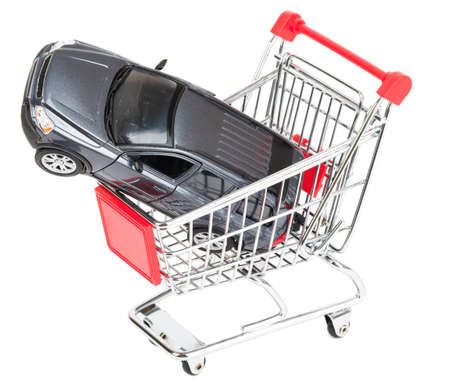 shopping cart isolated: Car in shopping cart isolated on white background, closeup